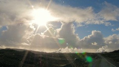 Icelandic landscape, sun is shining to a camera through clouds,geothermal Stock Footage