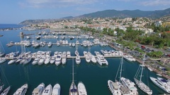 Townscape with many boats on moorage in Sun port at summer Stock Footage
