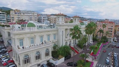 Townscape with edifice of Casino San Remo on street with traffic Stock Footage