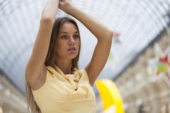 Beautiful blonde woman in yellow dress Stock Photos