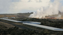 White steam from hot spring and big pipes of geothermal Power Plant in Reykjanes Stock Footage