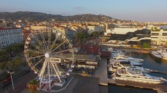 City traffic near observation wheel amusement and Harbor Station Stock Footage