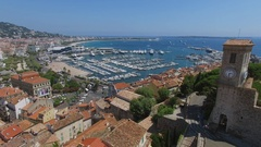 Many vessels in Cannes Old Port Marina and old quarter Le Suquet with tower Stock Footage
