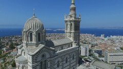 Edifice of Notre Dame de la Garde and coastal city district at summer Stock Footage