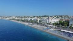 Townscape with transport traffic on English Promenade near hotel Negresco Stock Footage