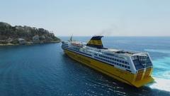 Ferryboat Mega Express Two sails near coastal town at summer Stock Footage
