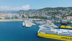 Mega Express Two ferryboat sails near port of Nice and Mont Boron quarter Stock Footage
