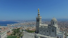 Panorama of coastal city with edifice of Notre Dame de la Garde and Old port Stock Footage