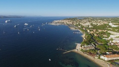 Many vessels sail in sea near New port and coastal town at summer Stock Footage