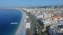 Cityscape with traffic on English Promenade and sea beach Stock Footage