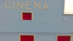 An old cinema with the sign. blue walls.and red windows Stock Footage