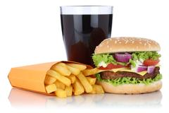 Cheeseburger hamburger and fries menu meal combo cola drink isolated Stock Photos