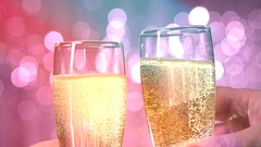 Toast with champagne at the festive blurred flickering background. Stock Footage