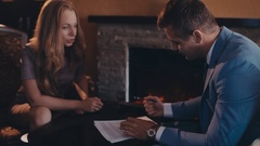 View of a Young attractive employer doing a job interview to a woman Stock Footage