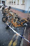 Burnt motorbike. Insurance matters Stock Photos