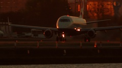 London City Airport - Golden hour telephoto shot of British Airlines jet Stock Footage
