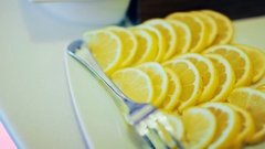 Sliced lemon on plate Stock Footage