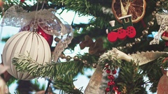New House on the Christmas tree. Mortgage. Woman is putting toys on a Tree. Stock Footage