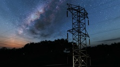 Electricity pylons and lines. Milky Way stars at night Stock Footage