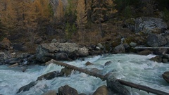 White Water Cascading Shallow Stream Flowing Between Grey Rocks In Siberian Stock Footage