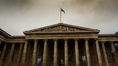 Wide angle gimbal shot showing the entrance of the British Museum in London Stock Footage