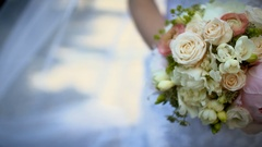 Bride holding beautiful rose Bouquet on wedding day Arkistovideo