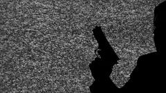 Silhouette tv noise man gun guarding Stock Footage