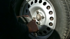 Screw bolts on the wheel the car Stock Footage
