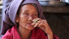 Old woman smoking a big handmade cigar. Inle Lake, Myanmar, Burma Stock Footage