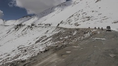 Motobikers driving in a snowy mountain Stock Footage