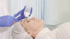 Master beautician prepares the patient for the procedure Stock Footage