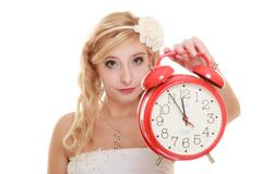 Wedding. Time to get married. Bride with alarm clock. Stock Photos
