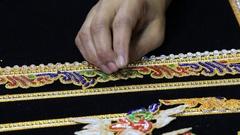 Burmese tapestry masters woman work with kalaga. Mandalay , Burma , Myanmar Stock Footage