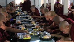 Hundreds of Buddhist monks eating lunch at Monastery in Mandalay, Myanmar, Burma Stock Footage