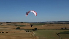 Paraglider in French countryside Stock Footage