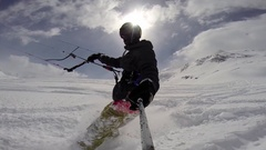 A young man snow kiting on a snowboard, slow motion. Stock Footage