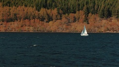 Small sailboat plying through Loch Ness in Scotland, UK Stock Footage