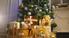 Luxury gift boxes under Christmas tree, New Year home decorations, golden Stock Footage