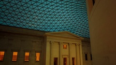 Gimbal shot of the Great Court of the British Museum during evening time Stock Footage