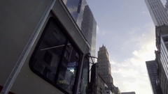 USPS mail truck driving in Midtown Manhattan with skyscrapers and hotel NYC Stock Footage