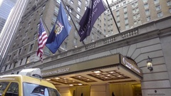 Flags InterContinental Barclay hotel tilting down taxicab Midtown Manhattan NYC Stock Footage