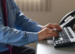 Hands of office worker typing on the keyboard Stock Photos