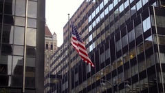 American flag waving and office buildings in Midtown Manhattan NYC Stock Footage
