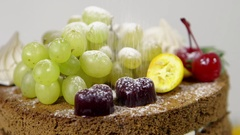 Sprinkle powder sugar on tasty cake Stock Footage