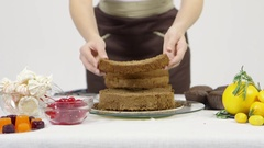 Confectioner decorates cakes Stock Footage