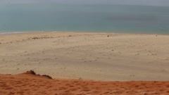 Red and white sand above blue ocean in Francois Peron NP Stock Footage