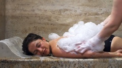 An attractive brunette smiling, relaxing and enjoying the turkish bath Stock Footage