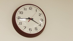 Boring office clock ticking on plain wall Stock Footage