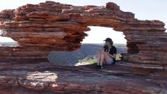Girl sitting in Nature's Window in Kalbarri NP Stock Footage