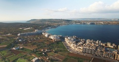 Aerial shot over Maltese buildings in Mellieha Stock Footage